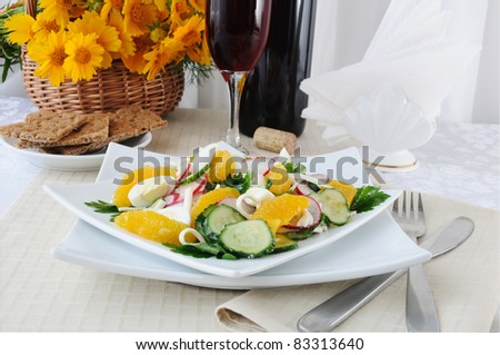 Salad of radish and cucumber with egg, cheese and orange
