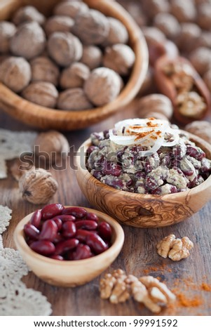 Salad of red beans with walnuts sauce (Georgian cuisine), selective focus - stock photo