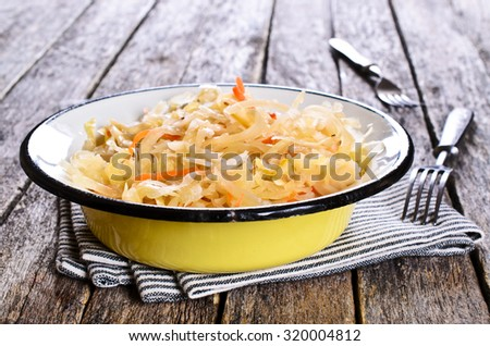 Salad of sauerkraut and carrots in rustic style. Selective focus. - stock photo