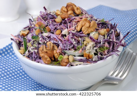 salad of shredded cabbage with nuts in milk sauce - stock photo