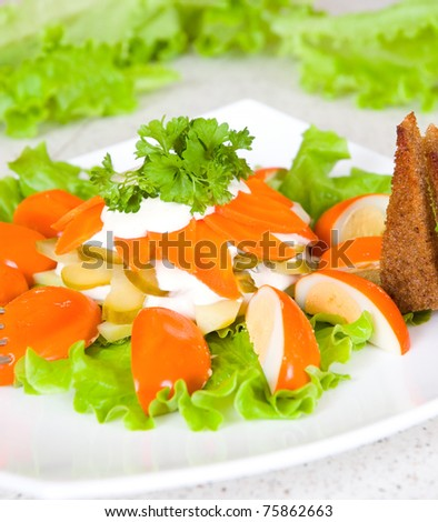 salad of smoked eggs, lettuce and cucumbers
