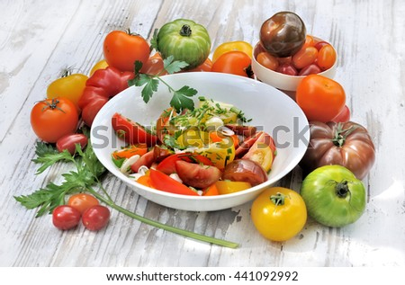 salad of tomatoes in a plate with various tomatoes  - stock photo