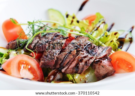 salad of vegetables and meat on dish - stock photo