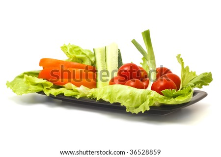 salad on plate isolated on white