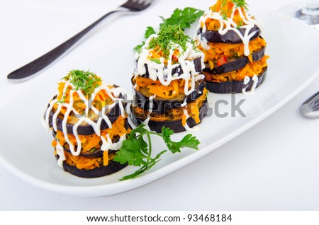 Salad pyramids served in the plate - stock photo