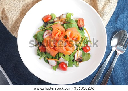 Salad Rocket Smoked Salmon, Radish, Tomatoes with Balsamic Dressing - stock photo