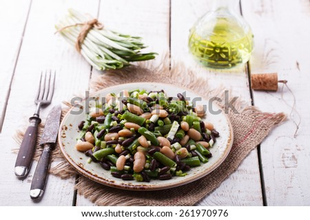 Salad three-bean with garlic. - stock photo