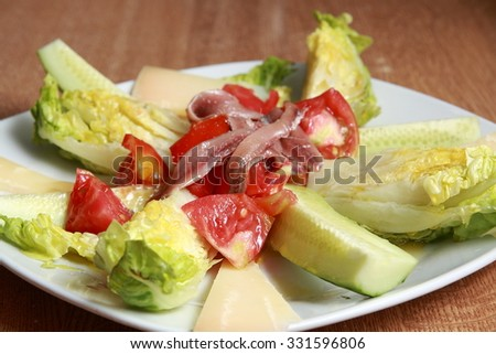 salad with anchovies, tomato, cucumber, lettuce and cheese
