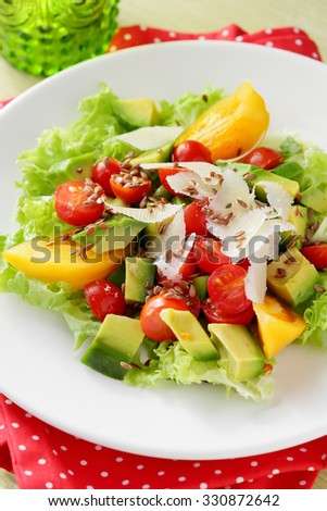salad with avocado on plate, close-up