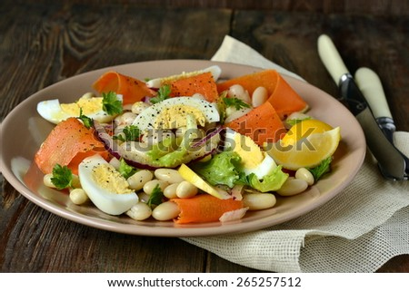 Salad with beans, egg, carrot and apple