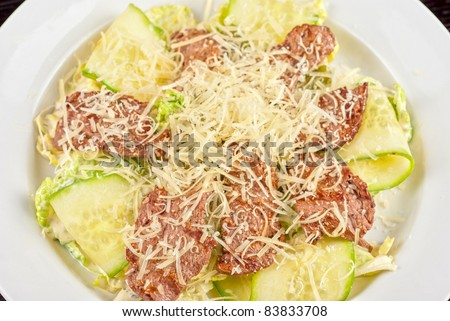 Salad with beef, lettuce, cucumber, string beans, Chinese cabbage and sauce - stock photo
