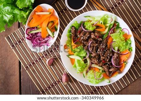 Salad with beef teriyaki. Top view - stock photo