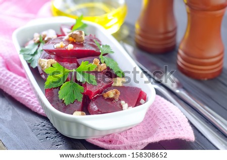 salad with beet and walnuts - stock photo