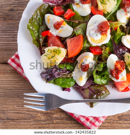 Salad with boiled egg - stock photo