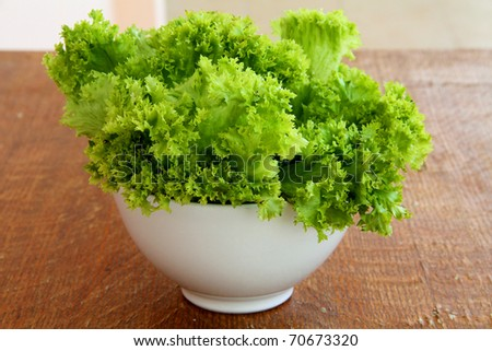 salad with Butter Lettuce on wooden background