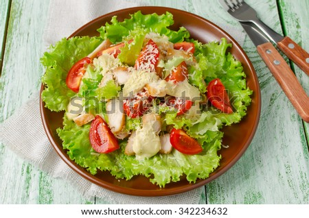Salad with chicken and vegetables, sprinkled with grated cheese - stock photo