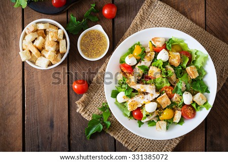 Salad with chicken, mozzarella and cherry tomatoes. Top view - stock photo