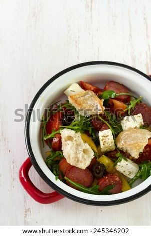 salad with chourico, cheese and bread - stock photo