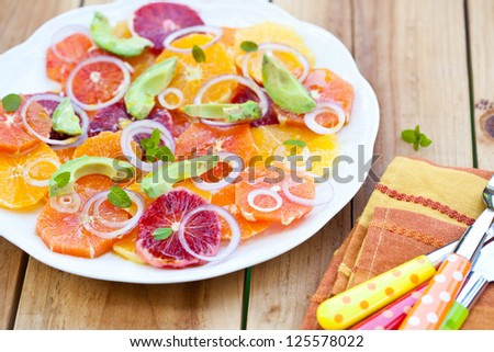 Salad with Citrus Fruits, Avocado and Onion. Also available in vertical format. - stock photo
