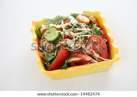Salad with cucumbers, tomatoes and herbs