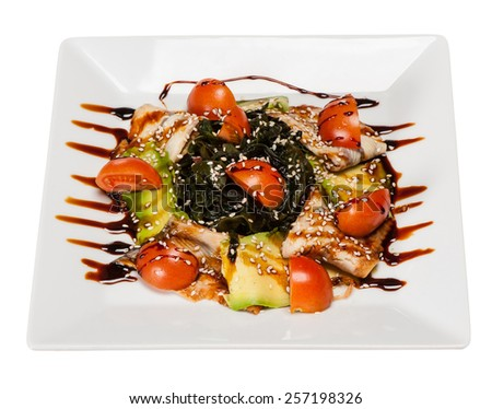 salad with eel, avocado, cherry tomatoes, lettuce, sesame, salad dressing - stock photo