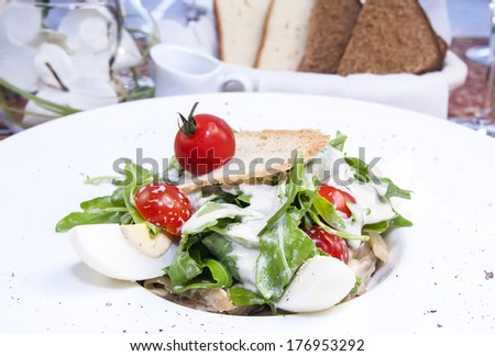 salad with eggs and vegetables with sauce in a restaurant