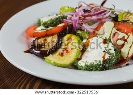 Salad with feta cheese and vegetables. Tasty and healthy food, Italian food - stock photo