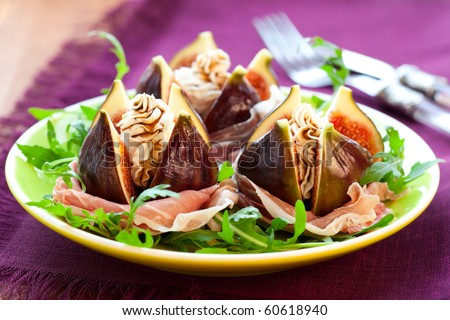 salad with fresh figs, cheese,prosciutto,rocket  and balsamic - stock photo