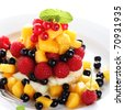 Salad with fresh fruit and berries on  white plate - stock photo