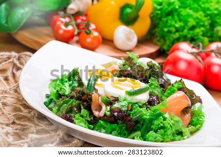 Salad with fresh salmon and eggs