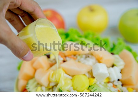 Salad with fresh vegetable,closeup salad dressing