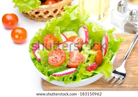 salad with fresh vegetables and ingredients for salad closeup top view - stock photo