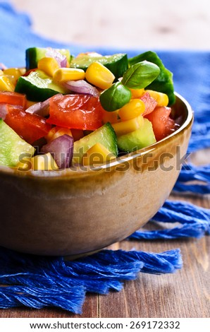 Salad with fresh vegetables in a ceramic dish