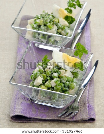 salad with green pepper sauce in glass egg salad on a linen napkin