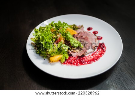 salad with grill pork, pine nuts, orange and cranberry sauce