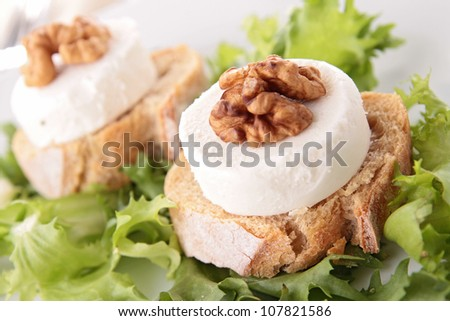 salad with grilled bread and goat cheese - stock photo