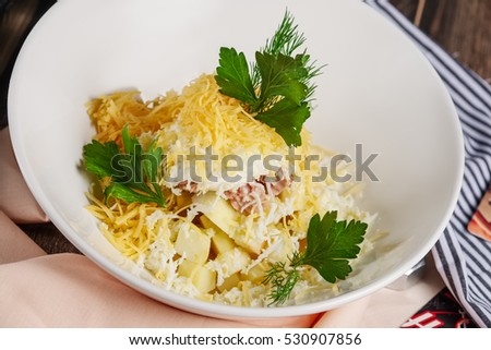 Salad with ham, cheese, egg and apple