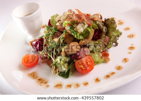 Salad with meat and pesto sauce on plate - stock photo