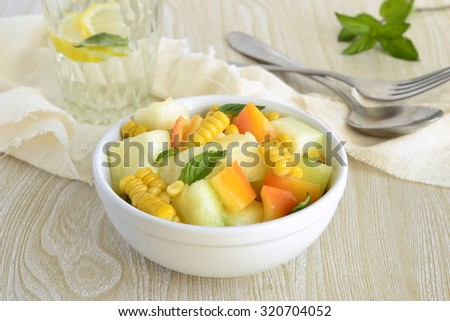 Salad with melon, corn and sweet pepper