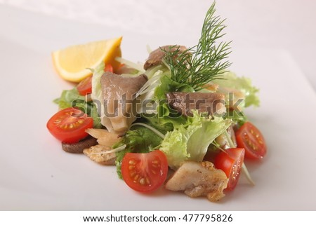 Salad with mushrooms and tomatoes on plate