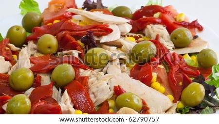 Salad with olives, tuna and peppers - stock photo
