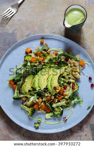 Salad with quinoa, butternut squash, pomegranate and avocado