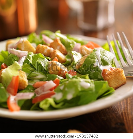 salad with ranch dressing, tomatoes, onions, and croutons