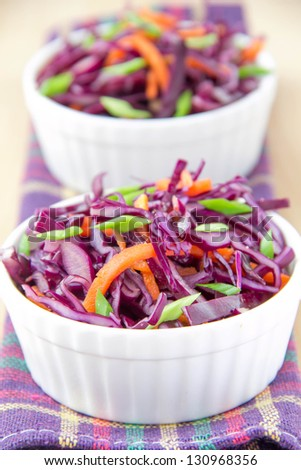 Salad with red cabbage  and carrot in white cup - stock photo