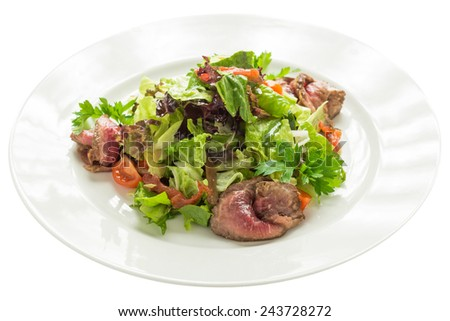 Salad with roast beef and vegetables isolated on white background. Clipping path - stock photo