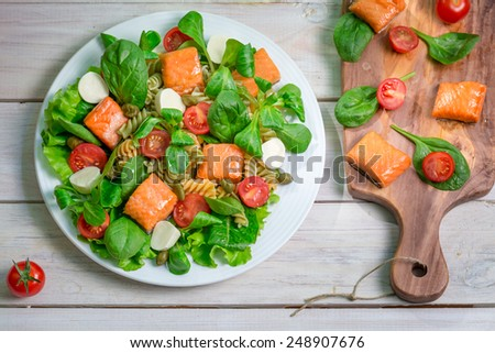 Salad with salmon and fresh vegetables - stock photo