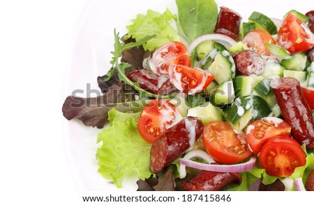 Salad with sausages. Close up. Whole background.