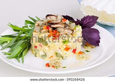 salad with seafood, mussels, basil and tarragon seaweed - stock photo