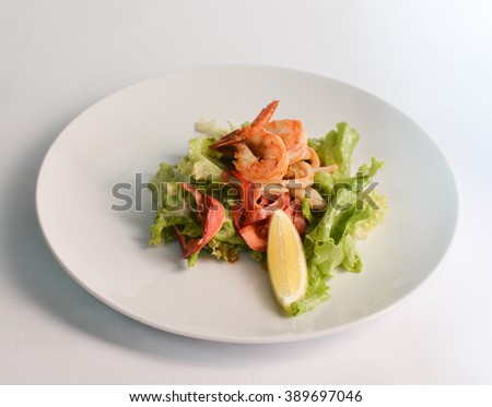 Salad with shrimp and seafood  - stock photo