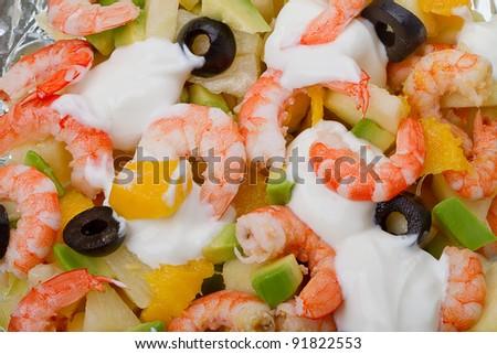 Salad with shrimp, pineapple, mango, avocado, olives and mayonnaise - stock photo